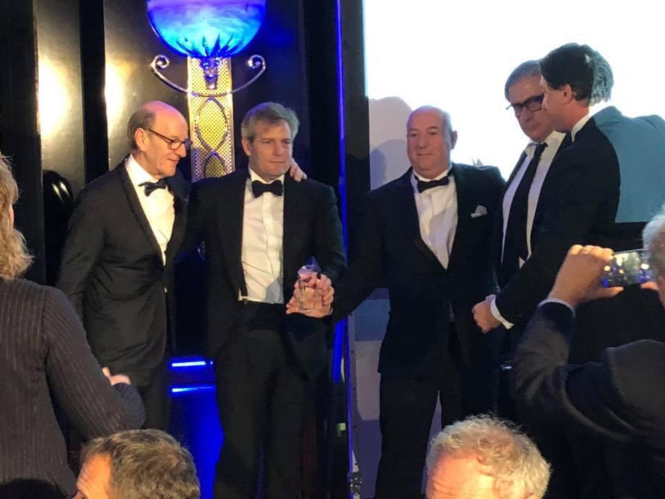 Nella fotografia l'amministratore delegato de La Marzocco, Guido Bernardinelli (secondo da destra), il membro del board e consigliere d'amministrazione, Kent Bakke (primo da sinistra), il direttore marketing, Chris Salierno - (secondo da sinistra con il mano il premio in cristallo in mano) anche quest'anno membro delle giuria dell'European Coffee Symposium - e il General Manager presso La Marzocco UK & Ireland, Paul Kelly (secondo da sinistra) mentre ritirano il premio sul palco degli awards